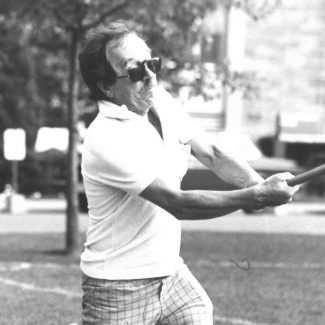 John Beckwith swinging a baseball bat.