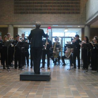 Gillian McKay conducting U of T Brass in EJB lobby, 6 December 2010.