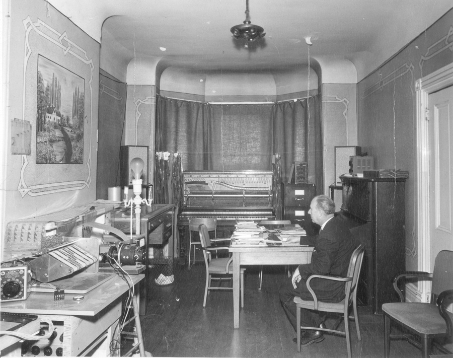 Professor Myron Schaeffer in the first electronic music studio in a house on Division St on U of T St. George campus, 1959
