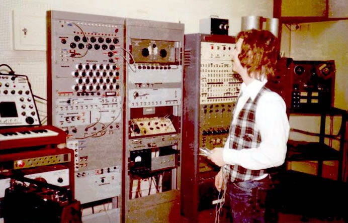 Bruce Pennycook working in the University of Toronto Electronic Music Studios (UTEMS) ca. 1975. In front of him is the Serial Structure Sound Generator (SSSG), built by Hugh Le Caine.